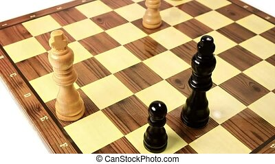 White king under attack by a black - Chess game board,...