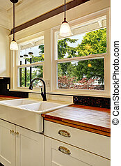 White kitchen cabinet with wooden counter top - White...