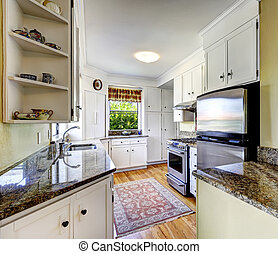 White kitchen cabinets with granite tops