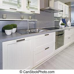 White kitchen - Full frame of simple white modern kitchen