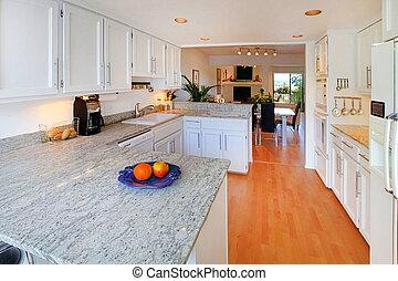 White kitchen - Open floor plan in an apartment in Gig...