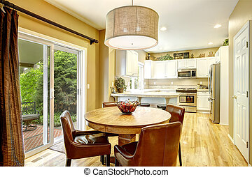 White kitchen room interior with dining area