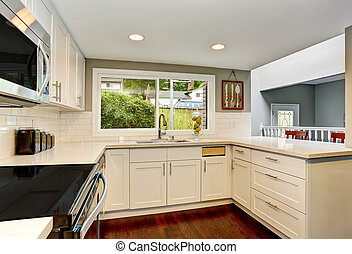 White kitchen room interior With hardwood floor.