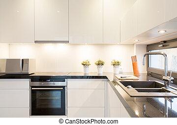 White kitchen unit - Close-up of white kitchen unit in ...