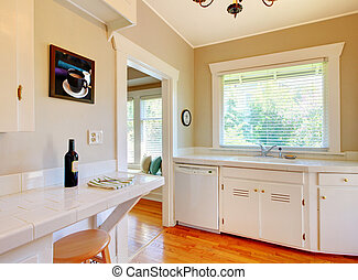 White kitchen with cherry hardwood floor.