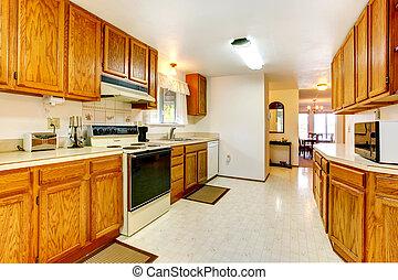 White kitchen with wooden storage combination