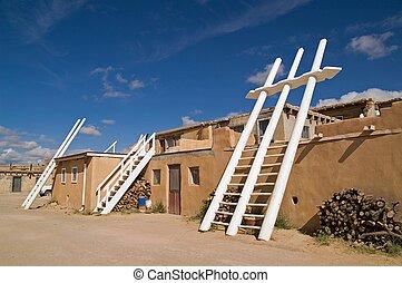 White Kiva Ladders in a New Mexican Pueblo