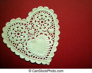 White Lacey Heart - A large white lacey heart on a red ...