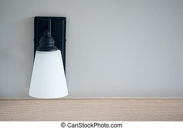 White lamp against the gray wall
