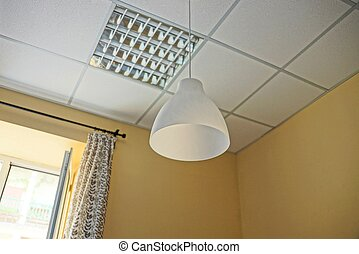 white lamp on the ceiling in the room with a window