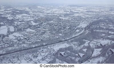 White lands in winter - Scenic view from air of white snow...