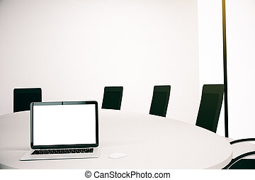 White laptop in conference room