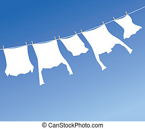 White laundry hanging to dry on a clothes-line.