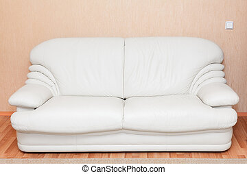 White leather couch in the room