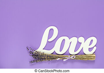 White letters forming word LOVE written with beautiful dried...