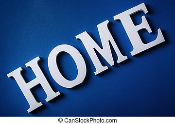 White letters with word HOME