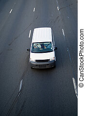 White light delivery truck on highway