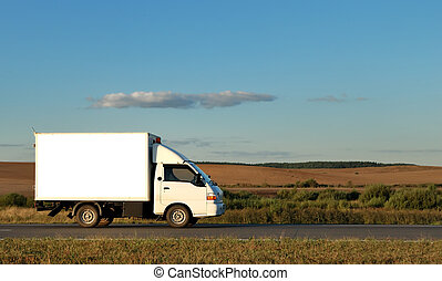 White Light-duty truck on highway over blue sky. See my...