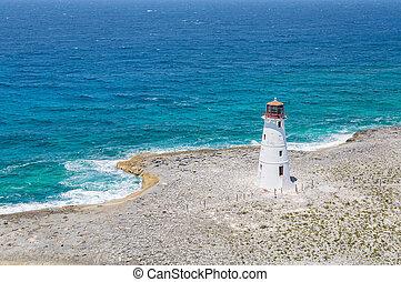 White Lighthouse on Curved Coastline