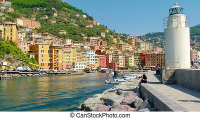 white lighthouse town pier - colored buildings - camogli on...
