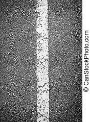 White line on black asphalt road