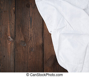 white linen towel on wooden background, top view