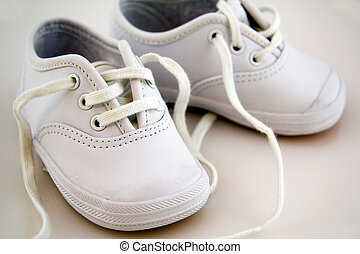 White Little Baby Shoes Isolated on a Background