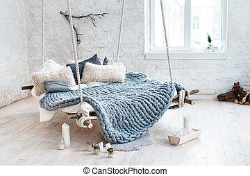 White loft interior in classic scandinavian style. Hanging...