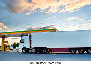 White lorry is at a fuel station