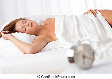 White lounge - Woman sleeping in white bed