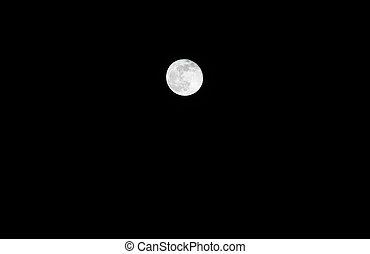 white magic full moon on a dark night