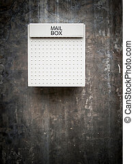 White mail box on wall