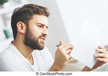 White man examining document side