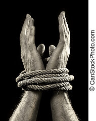white man hands wrapped with rope around wrists in captivity , victim abused , slave of work , respect for human rights and exploitation concept isolated on black background
