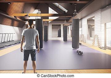 White man in gym interior