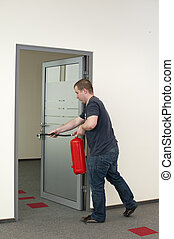 white man running with a fire extinguisher