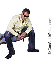 white man sitting on chair relaxed