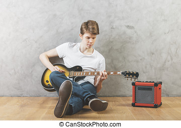 White man with guitar - Portrait of white man sitting on...