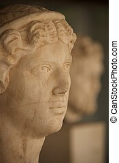 White marble head of woman beside man