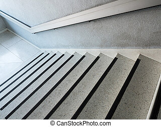 White marble pattern staircase with the metal handrail.