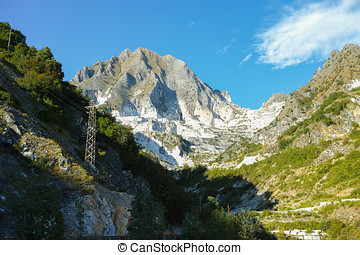 White marble quarries of Carrara in the Apuan alps Massa -...