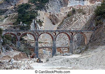 White marble quarry, bridge and excavators. Apuan, Carrara, Tusc