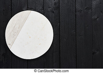 White marble serving plate on black wooden table