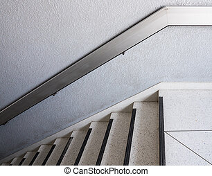 White marble staircase with the metal handrail.