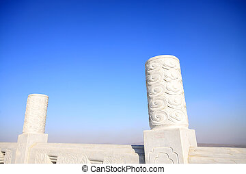 white marble stone works under the blue sky