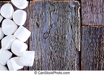 marshmallows - white marshmallows on the wooden table, fresh...