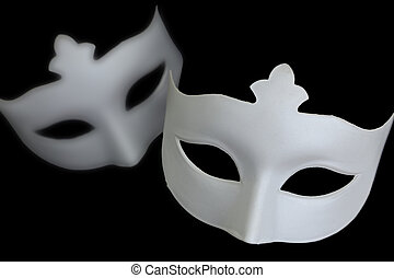 White mask on black background