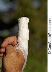 White medicine bandage on human injury hand finger