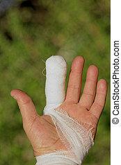 White medicine bandage on human injury hand finger - white...