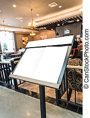 White menu board in front of the restaurant.